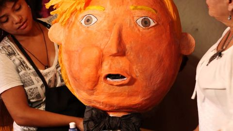 """A Trump piñata is set up inside Lorena Robletto's shop in downtown Los Angeles. Piñatas in Trump's image <a href=""""http://www.cnn.com/2015/07/22/politics/maevewest-donald-trump-2016-silent-majority/"""">became hot sellers</a> following outrage and anger over his rhetoric about Mexican immigrants."""