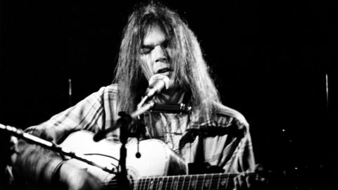 """Young's solo career in the '70s presented a successful mix of acoustic and electric folk rock. His signature voice and personal lyrics give emotional weight to songs, like the existential anxiety in """"Old Man"""" and the aimless longing in """"Heart of Gold."""""""
