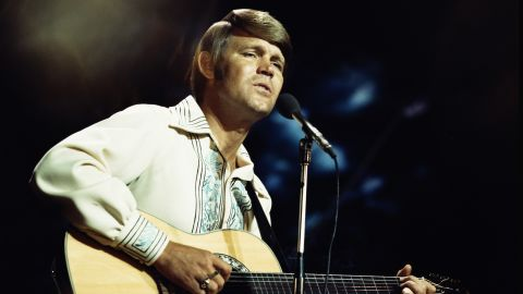 """A """"good ol' boy"""" with top-notch musical talent, <a href=""""https://www.cnn.com/shows/glen-campbell-ill-be-me"""" target=""""_blank"""">Campbell</a> is among the most successful country-crossover acts to date. His two giant hits in the '70s were """"Rhinestone Cowboy"""" and """"Southern Nights."""""""