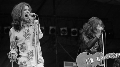 """This English rock band had a string of hits in the '60s, but one of its most memorable -- and controversial -- songs, """"Lola,"""" came at the dawn of the '70s. The song's gender-bending narrative was an atypical subject for the Kinks but speaks to the fluidity of sex and gender that was becoming more common in the popular music of the decade."""