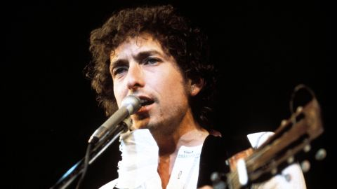 """Dylan's work in the '70s proved that the """"voice of a generation"""" could evolve, even thrive, after '60s success. His most popular song of the decade, """"Knockin' on Heaven's Door,"""" is one of the most-covered Dylan songs of all time. Dylan became a born-again Christian in 1978, releasing the gospel-influenced album """"Slow Train Coming"""" the following year. It featured """"Gotta Serve Somebody,"""" his last hit single of the decade."""