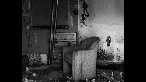 A hotel chair sits inside a former Ramada hotel in New Orleans. The hotel, which is now abandoned, sustained 4 feet of flooding during Katrina.