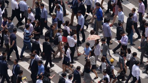 People cross a street in Seoul on June 2, 2015. South Korea's health ministry confirmed that two people have died from Middle East Respiratory Syndrome (MERS), the country's first fatalities from the virus. AFP PHOTO / Ed Jones ED JONES/AFP/Getty Images