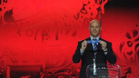 FIFA official Christian Unger plays his part in Saturday's draw.