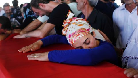 """Mourners in Gaziantep, Turkey, grieve over a coffin Tuesday, July 21, during a funeral ceremony for the victims of a suspected ISIS suicide bomb attack. <a href=""""http://www.cnn.com/2015/07/20/world/turkey-suruc-explosion/"""">That bombing killed at least 31 people</a> in Suruc, a Turkish town that borders Syria. Turkish authorities blamed ISIS for the attack."""