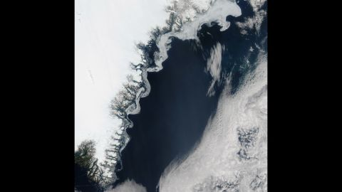Aqua satellite took this image of sea ice on the eastern coast of Greenland on July 16. The swirls of ice are caused by winds and currents that steer the ice, according to NASA.