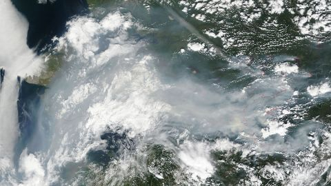 Fires have burned thousands of acres in Alaska. NASA's Terra satellite took this photo of smoke of smoke and haze over Alaska on July 12. Fires are outlined in red. The Alaska Interagency Coordination Center says about 300 fires were actively burning when the image was taken.