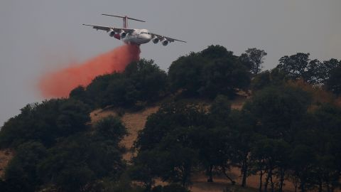 A firefighting aircraft drops retardant on a ridge to combat the Wragg Fire on July 23.
