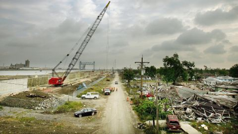 On April 25, 2006, workers in the Lower Ninth Ward rebuild the levee that was breached by Hurricane Katrina along the Industrial Canal.