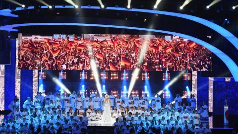 Singer Polina Gagarina and conductor Valery Gergiev perform at the ceremony to mark the preliminary draw for the 2018 World Cup.
