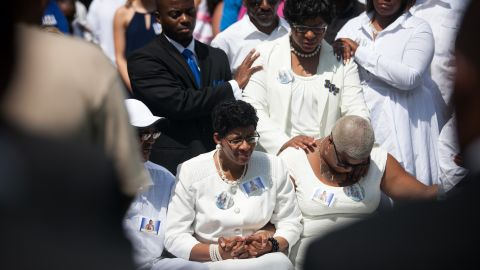 The mother of Sandra Bland, Geneva Reed-Veal, center, and sister Shavon Bland, right, mourn at the grave site during the funeral at Mt. Glenwood Memorial Gardens West cemetery, on Saturday, July 25 in Willow Springs, Illinois.