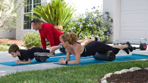Myofascial release: You can roll virtually every part of your body, but in the interest of time during family workouts, stick to the major muscles of the legs and back. Roll up and down for about 30 seconds each.