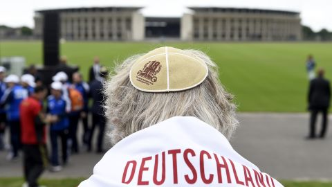 """A man wears a Kippa at the """"Maifeld"""" -- a place used by Nazis for mass rallies, near Berlin's Olympic Stadium  -- during a Memorial ceremony for the victims of the Holocaust. Six million Jews were murdered by the Nazi regime and its collaborators."""