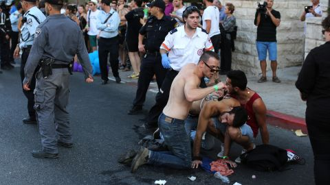 A stabbing victim receives assistance at a gay pride parade in Jerusalem after police say an Orthodox Jew stabbed six people Thursday, July 30.  Two of the victims were injured seriously, Israeli police spokeswoman Luba Samri said. The suspect, Yishai Shlissel, was recently released from prison for committing a similar crime 10 years ago.