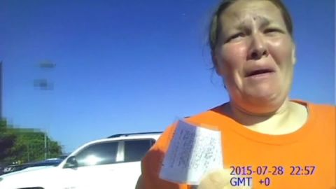 Mother reaction baby in hot car body cam pkg_00001318.jpg