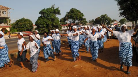 Women in Monrovia celebrate after the World Health Organization declared Liberia Ebola-free on May 9, 2015. Other cases have recurred since, however. Two people in Liberia have died of the disease since the end of June, just weeks after the WHO declared the nation free of the disease.