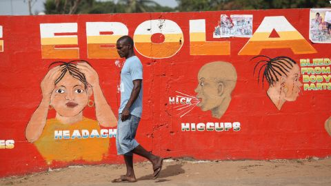 A man walks past an Ebola awareness painting in Monrovia on March 22, 2015.