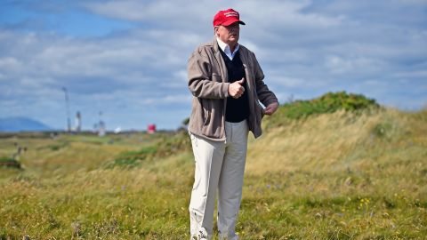 Trump walks his Turnberry golf course on July 30.