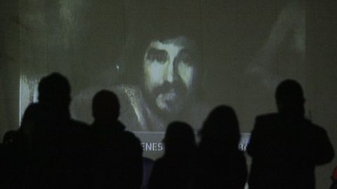 Relatives watch a video of the trapped miners on August 26. Chilean television aired footage of the miners, showing them in good spirits and explaining how their underground shelter was set up.