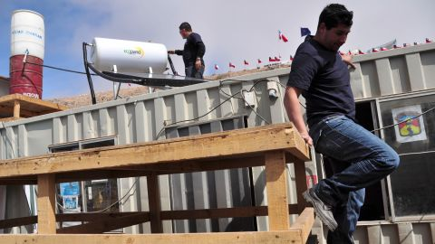 On September 8, volunteers install heating and water purification systems at the La Esperanza tent city that sprang up outside the mine as news of the collapse spread. Esperanza means hope in English.
