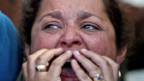 Loreto Campbell, a relative of miner Jorge Galleguillos, reacts while watching his rescue on a TV screen at the camp outside the mine on October 13. Galleguillos was the 11th of 33 miners who were rescued.