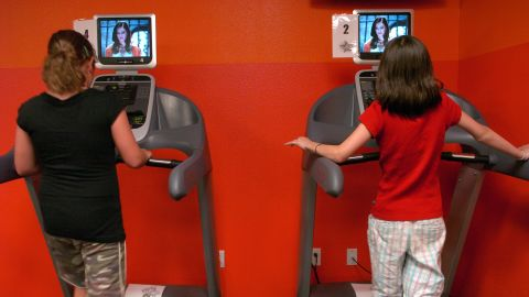 To make it easier to stay off the couch, some people have a treadmill, exercise bike or a stair stepper in front of the TV.