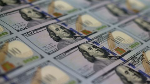 Newly redesigned $100 notes lay in stacks at the Bureau of Engraving and Printing on May 20, 2013 in Washington, D.C.