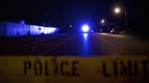 Caption:PHILADELPHIA, PA - MAY 13: A man walks past a police truck with its flickering blue lights near the wreckage of an Amtrak passenger train that derailed carrying more than 200 passengers from Washington, DC to New York on May 13, 2015 in north Philadelphia, Pennsylvania. At least five people were killed and more than 50 others were injured in the crash. (Photo by Mark Makela/Getty Images)
