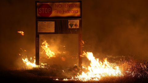 Flames from the Rocky Fire burn through dry grass August 2 near Clearlake.