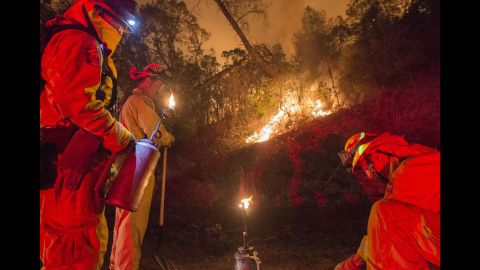 Firefighters light backfires in an attempt to control the blaze near Clearlake on August 2.