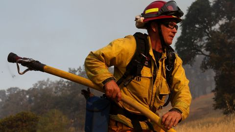 A firefighter prepares to douse spot fires in Lower Lake on July 31.