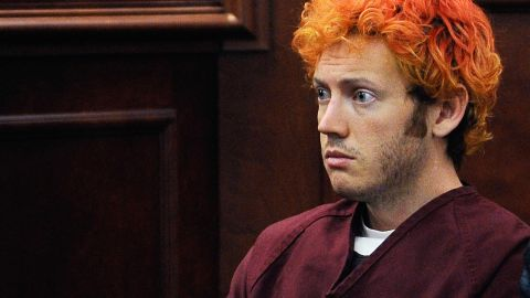"""CENTENNIAL, CO - JULY 23:  Accused movie theater shooter James Holmes makes his first court appearance at the Arapahoe County on July 23, 2012 in Centennial, Colorado. According to police, Holmes killed 12 people and injured 58 others during a shooting rampage at an opening night screening of """"The Dark Knight Rises"""" July 20, in Aurora, Colorado.  (Photo by RJ Sangosti/Pool/Getty Images)"""