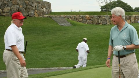 Donald Trump and Bill Clinton are pictured at the Trump National Golf Club on July 14, 2008, in Briarcliff Manor, New York.