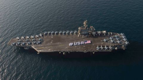 150628-N-VC236-071ARABIAN GULF (June 28, 2015) - Sailors spell out #USA with the American flag on the flight deck of the aircraft carrier USS Theodore Roosevelt in honor of the nation's upcoming Independence Day weekend. Theodore Roosevelt is deployed to the U.S. 5th Fleet area of operations as part of Theodore Roosevelt Carrier Strike Group supporting Operation Inherent Resolve, strike operations in Iraq and Syria as directed, maritime security operations and theater security cooperation efforts in the region. (U.S. Navy photo by Mass Communication Specialist 3rd Class Jackie Hart/Released)