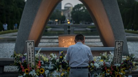 A man prays at the Hiroshima Peace Memorial last year ahead of the 70th anniversary ceremony of the atomic bombing of the city.