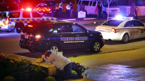 """A man kneels across the street from the historic Emanuel African Methodist Episcopal Church in Charleston, South Carolina, <a href=""""http://www.cnn.com/2015/06/18/us/gallery/charleston-south-carolina-church-shooting/index.html"""" target=""""_blank"""">following a shooting</a> in June 2015. Police say the suspect, Dylann Roof, opened fire inside the church, killing nine people. According to police, Roof confessed and told investigators he wanted to start a race war. <a href=""""http://www.cnn.com/2017/01/10/us/dylann-roof-trial/index.html"""" target=""""_blank"""">He was eventually convicted</a> of murder and hate crimes, and a jury recommended the death penalty."""