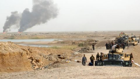 Smoke rises as Iraqi security forces bomb ISIS positions in the eastern suburbs of Ramadi, Iraq, on August 6.