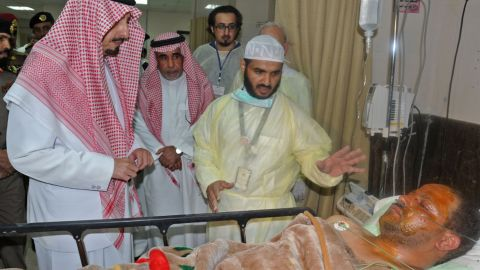 """The governor of the Asir region in Saudi Arabia, Prince Faisal bin Khaled bin Abdulaziz, left, visits a man who was wounded in <a href=""""http://www.cnn.com/2015/08/06/middleeast/saudi-arabia-mosque-attack/"""" target=""""_blank"""">a suicide bombing attack on a mosque</a> in Abha, Saudi Arabia, on August 6. ISIS claimed responsibility for the explosion, which killed at least 13 people and injured nine others."""