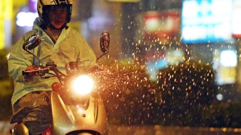 A motorcyclist rides on the street as Typhoon Soudelor approaches eastern Taiwan, in New Taipei City on August 7, 2015. An eight-year-old girl died after being swept out to sea off Taiwan as Typhoon Soudelor bore down on the island, forcing thousands to flee and troops to be placed on standby, officials said. AFP PHOTO / Sam YehSAM YEH/AFP/Getty Images