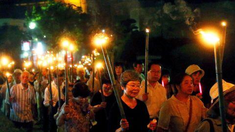 Catholics hold bamboo torches during a peace march from the Urakami Cathedral toward the Peace Memorial park in Nagasaki, Japan on August 9. Japan  marked the 70th anniversary of the atomic bombing of Nagasaki that claimed more than 70,000 lives in one of the final chapters of World War II.