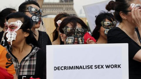 Sex workers take part in a demonstration on June 5, 2015 in Trocadero Square, Paris.