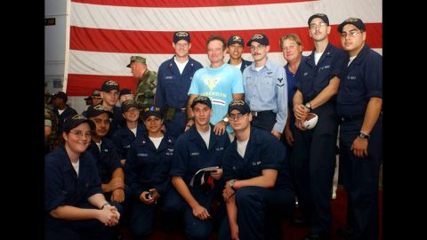 """<a href=""""http://ireport.cnn.com/docs/DOC-1161067"""">Aurora Contreras</a> of the U.S. Navy says meeting Robin Williams aboard the USS Harry S. Truman was one of her fondest memories from her 2004 deployment in the Persian Gulf. Contreras is shown kneeling to the left of the soldier whom Williams was standing behind. """"To see him there was a major highlight of our time onboard,"""" she said."""