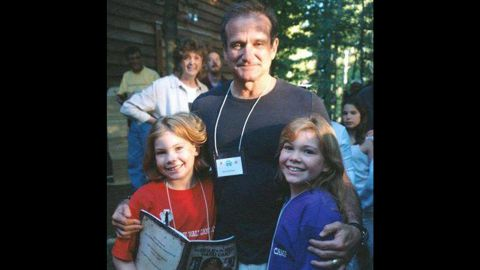 """At age 9, <a href=""""http://ireport.cnn.com/docs/DOC-1161134"""">Stephanie Wilson</a>, left, met Robin Williams while at a camp for sick children. In 1999, she got to perform with the comedian at a fundraising gala. """"He was hilarious. I wish he had known how much we appreciated him,"""" she said."""
