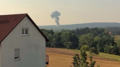 Smoke is visible in the distance where a U.S. F-16 crashed Tuesday in Germany's Bavaria region.