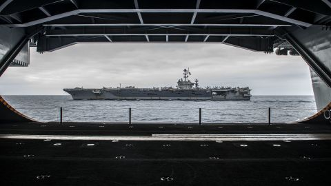 """The Nimitz-class aircraft carrier USS George Washington (CVN 73) is seen from inside its sister ship, the USS Ronald Reagan (CVN 76), on August 7 off the coast of California as the two ships prepare for<a href=""""http://www.cnn.com/2015/03/04/us/us-navy-three-presidents/""""> a """"hull swap.""""</a>  Over 10 days in San Diego, much of the crew of each ship will transfer to the other. When completed, the Reagan will head to forward deployment in Japan, where the Washington had been. The Washington will head to Newport News, Virginia, for an overhaul."""