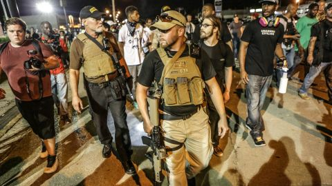 """Members of a group calling themselves the """"Oath Keepers"""" appeared in Ferguson carrying large guns on August 10, 2015, one day after a police confrontation led to a protester being shot. August 9 markes the one year anniversary of the death of Michael Brown."""