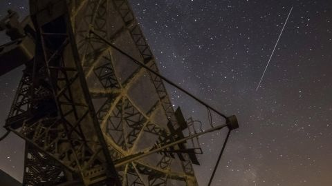 A Perseid meteor streaks across the sky above the Astronomical Institute of the Academy of Sciences of the Czech Republic in Ondrejov on August 12.