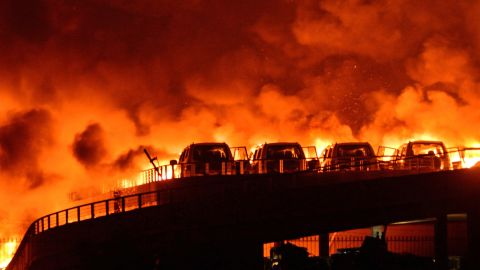Fires continued to burn near the site of the explosions in the early hours of Thursday, August 13.
