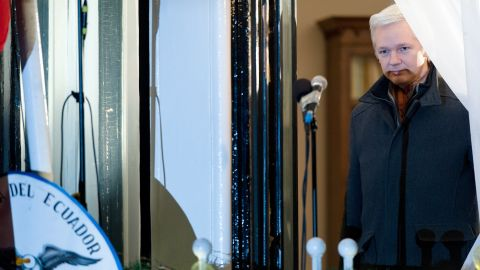 WikiLeaks founder Julian Assange prepares to address the media and supporters from the window of the Ecuadorian Embassy in London in 2012.
