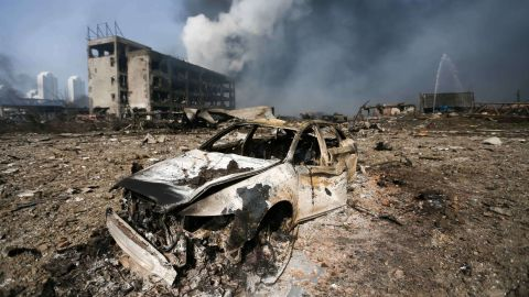 A damaged car is seen at the site of the massive explosions in Tianjin on August 13, 2015. Enormous explosions in a major Chinese port city killed at least 44 people and injured more than 500, state media reported on August 13, leaving a devastated industrial landscape of incinerated cars, toppled shipping containers and burnt-out buildings. CHINA OUT AFP PHOTOSTR/AFP/Getty Images